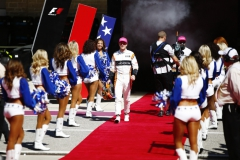 Circuit of the Americas, Austin, Texas, United States of America.Sunday 22 October 2017.Stoffel Vandoorne, McLaren, and Fernando Alonso, McLaren, with the Dallas Cowboys Cheerleaders on the grid.Photo: Andrew Hone/McLarenref: Digital Image _ONY2173