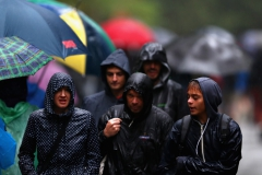MONZA, ITALY - SEPTEMBER 02: Fans shelter from the rain during final practice for the Formula One Grand Prix of Italy at Autodromo di Monza on September 2, 2017 in Monza, Italy. (Photo by Dan Istitene/Getty Images) // Getty Images / Red Bull Content Pool // P-20170902-17040 // Usage for editorial use only // Please go to www.redbullcontentpool.com for further information. //