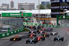 MONTREAL, QC - JUNE 11: Lewis Hamilton of Great Britain driving the (44) Mercedes AMG Petronas F1 Team Mercedes F1 WO8 leads Valtteri Bottas driving the (77) Mercedes AMG Petronas F1 Team Mercedes F1 WO8 Sebastian Vettel of Germany driving the (5) Scuderia Ferrari SF70H Max Verstappen of the Netherlands driving the (33) Red Bull Racing Red Bull-TAG Heuer RB13 TAG Heuer and the rest of the field towards the first corner during the Canadian Formula One Grand Prix at Circuit Gilles Villeneuve on June 11, 2017 in Montreal, Canada. (Photo by Mark Thompson/Getty Images) // Getty Images / Red Bull Content Pool // P-20170612-00112 // Usage for editorial use only // Please go to www.redbullcontentpool.com for further information. //