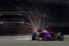 SINGAPORE - SEPTEMBER 16: Sparks fly behind Carlos Sainz of Spain driving the (55) Scuderia Toro Rosso STR12 on track during qualifying for the Formula One Grand Prix of Singapore at Marina Bay Street Circuit on September 16, 2017 in Singapore. (Photo by Clive Mason/Getty Images) // Getty Images / Red Bull Content Pool // P-20170916-00750 // Usage for editorial use only // Please go to www.redbullcontentpool.com for further information. //
