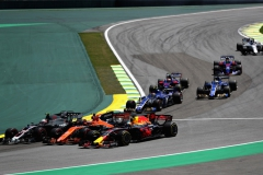 SAO PAULO, BRAZIL - NOVEMBER 12: Daniel Ricciardo of Australia driving the (3) Red Bull Racing Red Bull-TAG Heuer RB13 TAG Heuer Stoffel Vandoorne of Belgium driving the (2) McLaren Honda Formula 1 Team McLaren MCL32 and Kevin Magnussen of Denmark and Haas F1 battle into turn two at the start during the Formula One Grand Prix of Brazil at Autodromo Jose Carlos Pace on November 12, 2017 in Sao Paulo, Brazil. (Photo by Dan Istitene/Getty Images) // Getty Images / Red Bull Content Pool // P-20171112-00633 // Usage for editorial use only // Please go to www.redbullcontentpool.com for further information. //