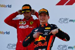 SPIELBERG, AUSTRIA - JUNE 30: Race winner Max Verstappen of Netherlands and Red Bull Racing celebrates on the podium as second placed Charles Leclerc of Monaco and Ferrari looks dejected during the F1 Grand Prix of Austria at Red Bull Ring on June 30, 2019 in Spielberg, Austria. (Photo by Mark Thompson/Getty Images) // Getty Images / Red Bull Content Pool  // AP-1ZTAA5HSW1W11 // Usage for editorial use only // Please go to www.redbullcontentpool.com for further information. //