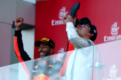 BAKU, AZERBAIJAN - JUNE 25: Daniel Ricciardo of Australia and Red Bull Racing celebrates on the podium as he offers a shoey to Lance Stroll of Canada and Williams after winning the Azerbaijan Formula One Grand Prix at Baku City Circuit on June 25, 2017 in Baku, Azerbaijan. (Photo by Dan Istitene/Getty Images) // Getty Images / Red Bull Content Pool // P-20170625-00852 // Usage for editorial use only // Please go to www.redbullcontentpool.com for further information. //