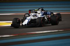 Yas Marina Circuit, Abu Dhabi, United Arab Emirates.Sunday 25 November 2018Sergey Sirotkin, Williams FW41, leads Romain Grosjean, Haas F1 Team VF-18.World Copyright: Andy Hone/Williams F1ref: _ONY5551