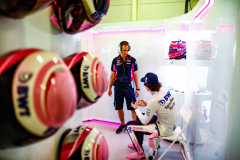 Lance Stroll, Racing Point, talks to an engineer