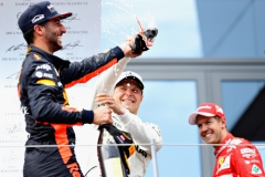 SPIELBERG, AUSTRIA - JULY 09: Race winner Valtteri Bottas of Finland and Mercedes GP tries to avoid doing a shoey on the podium from Daniel Ricciardo of Australia and Red Bull Racing during the Formula One Grand Prix of Austria at Red Bull Ring on July 9, 2017 in Spielberg, Austria. (Photo by Mark Thompson/Getty Images) // Getty Images / Red Bull Content Pool // P-20170709-02423 // Usage for editorial use only // Please go to www.redbullcontentpool.com for further information. //