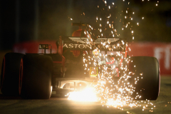 SINGAPORE - SEPTEMBER 15:  Sparks fly behind Daniel Ricciardo of Australia driving the (3) Aston Martin Red Bull Racing RB14 TAG Heuer on track during qualifying for the Formula One Grand Prix of Singapore at Marina Bay Street Circuit on September 15, 2018 in Singapore.  (Photo by Clive Mason/Getty Images) // Getty Images / Red Bull Content Pool  // AP-1WWK82D6W2111 // Usage for editorial use only // Please go to www.redbullcontentpool.com for further information. //