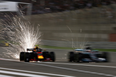 BAHRAIN, BAHRAIN - APRIL 08:  Sparks fly behind Max Verstappen of the Netherlands driving the (33) Aston Martin Red Bull Racing RB14 TAG Heuer and Lewis Hamilton of Great Britain driving the (44) Mercedes AMG Petronas F1 Team Mercedes WO9 on track during the Bahrain Formula One Grand Prix at Bahrain International Circuit on April 8, 2018 in Bahrain, Bahrain.  (Photo by Charles Coates/Getty Images) // Getty Images / Red Bull Content Pool  // AP-1VA3TKE3H2111 // Usage for editorial use only // Please go to www.redbullcontentpool.com for further information. //