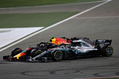 BAHRAIN, BAHRAIN - APRIL 08:  Max Verstappen of the Netherlands driving the (33) Aston Martin Red Bull Racing RB14 TAG Heuer battles with Lewis Hamilton of Great Britain driving the (44) Mercedes AMG Petronas F1 Team Mercedes WO9 on track during the Bahrain Formula One Grand Prix at Bahrain International Circuit on April 8, 2018 in Bahrain, Bahrain.  (Photo by Lars Baron/Getty Images) // Getty Images / Red Bull Content Pool  // AP-1VA4986J12111 // Usage for editorial use only // Please go to www.redbullcontentpool.com for further information. //