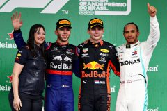 SAO PAULO, BRAZIL - NOVEMBER 17: Top three finishers Max Verstappen of Netherlands and Red Bull Racing, Pierre Gasly of France and Scuderia Toro Rosso and Lewis Hamilton of Great Britain and Mercedes GP celebrate on the podium during the F1 Grand Prix of Brazil at Autodromo Jose Carlos Pace on November 17, 2019 in Sao Paulo, Brazil. (Photo by Mark Thompson/Getty Images)