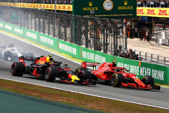 SAO PAULO, BRAZIL - NOVEMBER 11: Kimi Raikkonen of Finland driving the (7) Scuderia Ferrari SF71H and Max Verstappen of the Netherlands driving the (33) Aston Martin Red Bull Racing RB14 TAG Heuer battle for position at the start during the Formula One Grand Prix of Brazil at Autodromo Jose Carlos Pace on November 11, 2018 in Sao Paulo, Brazil.  (Photo by Mark Thompson/Getty Images) // Getty Images / Red Bull Content Pool  // AP-1XFYWEZ592111 // Usage for editorial use only // Please go to www.redbullcontentpool.com for further information. //