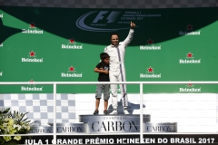Interlagos, Sao Paulo, Brazil.Sunday 12 November 2017.Felipe Massa, Williams Martini Racing, on the podium after the race with his son Felipinho.Photo: Andrew Hone/Williamsref: Digital Image _ONY9561