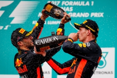 KUALA LUMPUR, MALAYSIA - OCTOBER 01: Race winner Max Verstappen of Netherlands and Red Bull Racing celebrates with third place finisher Daniel Ricciardo of Australia and Red Bull Racing on the podium during the Malaysia Formula One Grand Prix at Sepang Circuit on October 1, 2017 in Kuala Lumpur, Malaysia. (Photo by Lars Baron/Getty Images) *** BESTPIX *** // Getty Images / Red Bull Content Pool // P-20171001-02089 // Usage for editorial use only // Please go to www.redbullcontentpool.com for further information. //