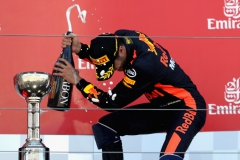 SUZUKA, JAPAN - OCTOBER 08: Third place finisher Daniel Ricciardo of Australia and Red Bull Racing celebrates on the podium during the Formula One Grand Prix of Japan at Suzuka Circuit on October 8, 2017 in Suzuka. (Photo by Mark Thompson/Getty Images) // Getty Images / Red Bull Content Pool // P-20171008-00847 // Usage for editorial use only // Please go to www.redbullcontentpool.com for further information. //