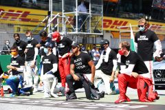 SPIELBERG, AUSTRIA - JULY 05: Lewis Hamilton of Great Britain and Mercedes GP, Pierre Gasly of France and Scuderia AlphaTauri  and some of the F1 drivers take a knee on the grid in support of the Black Lives Matter movement ahead of the Formula One Grand Prix of Austria at Red Bull Ring on July 05, 2020 in Spielberg, Austria. (Photo by Mark Thompson/Getty Images) *** BESTPIX *** // Getty Images / Red Bull Content Pool  // AP-24HRSP7612111 // Usage for editorial use only //